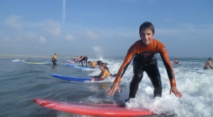 Surfing at Freedom Surf School Tramore